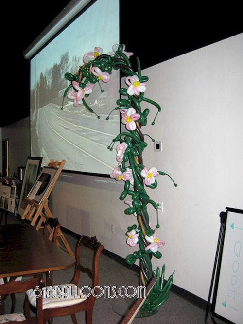 Flower half arch balloon sculpture by 616Balloons.com Grand Rapids, Mi. Premium balloon art & decor. Corporate events, private parties..