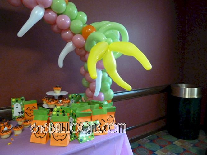 Monster table arch balloon sculpture claw & teeth detail by 616 Balloons Grand Rapids, Mi. Premium balloon art & decor. Corporate events, private parties..