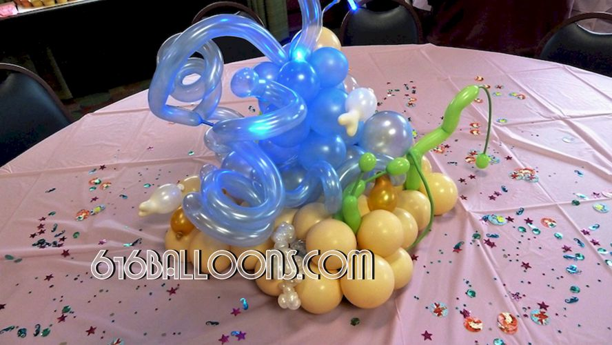 Little Mermaid themed baby shower balloon centerpiece by 616Balloons.com Grand Rapids, Michigan. Specializing in high end balloon art & decor for the best corporate or private parties and events in West Michigan.