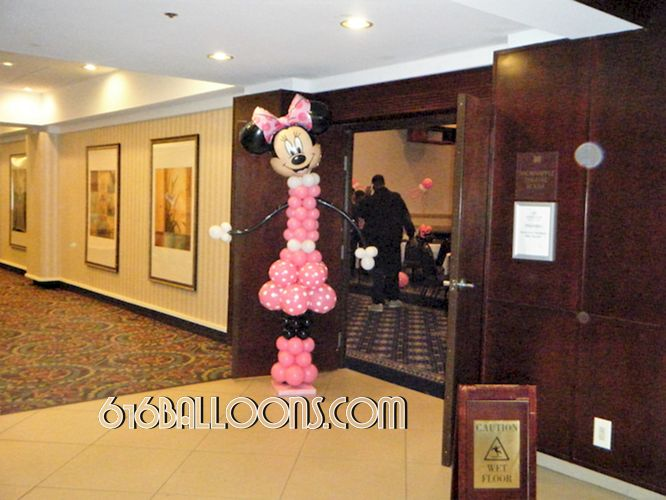 Minnie Mouse balloon column for baby shower by 616Balloons.com Grand Rapids, Michigan. Specializing in high end balloon art & decor for the best corporate or private parties and events in West Michigan.