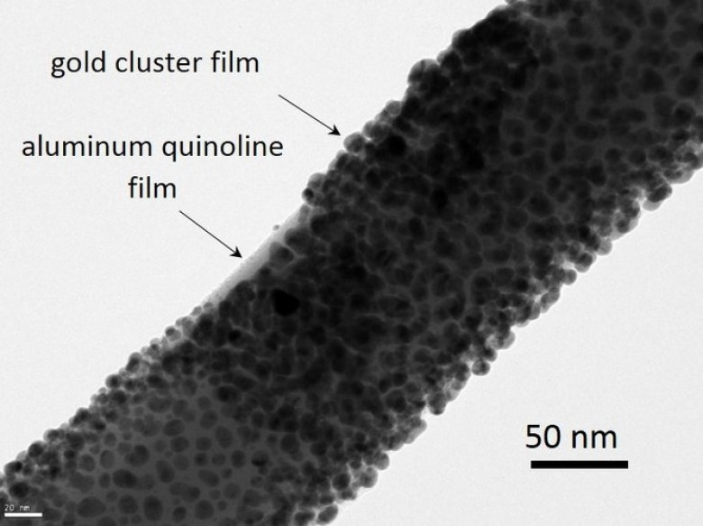 Transmission electron microscope (HRTEM) image of a GaAs-AlGaAs core-shell nanowire coated with nominally 10 nm aluminum quinoline and a 5 to 10 nm thick gold cluster film on top. Melodie Fickenscher (Advanced Materials Characterization Center College of Engineering and Applied Science) University of Cincinnati, CC BY-ND