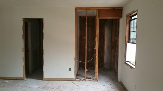 Tiny Master Closet with drywall removed
