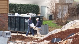 Last fixture to the dumpster, fireplace already in there