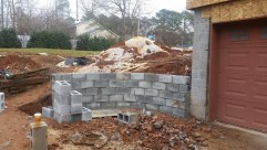 Retaining wall block in place