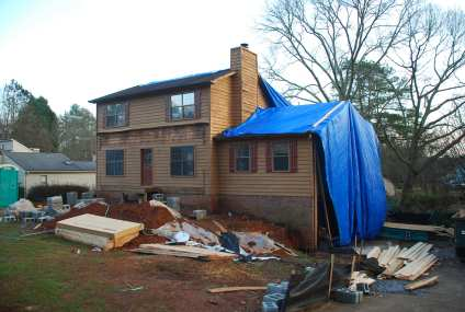 Mega-tarps go on to protect house