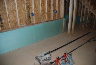 Back wall of shop with foamboard in place