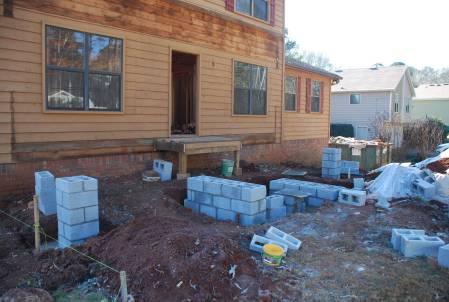 Blockwork begins at front porch