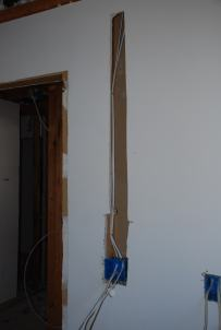 How do you run a wire in an existing wall?