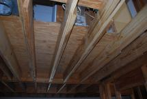 Floor joists 'sistered' where stair was