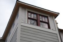 Corner boards and siding at upper stair wall