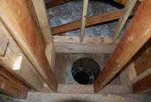New chimney framing with old fireplace flue removed
