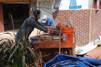 Jonathan cutting brick for chimney veneer with wet saw