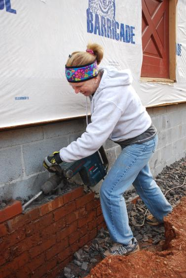 Stephanye taking her turn with the hammer drill