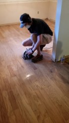 Jonathan working on removing old wood flooring