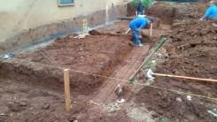 Footings dug - laying out rebar