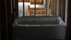 Upper bath tub filled with water as a test for leaks