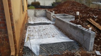Gravel, vapor barrier, wire mesh in place