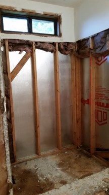 Upstairs shower gone - there was no insulation in exterior wall behind it