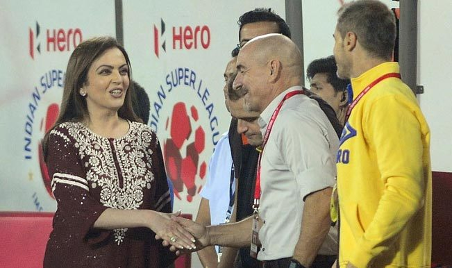 Nita Ambani distributing the silver and bronze medals. She won the gold.