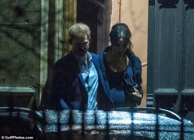 Low profile: Last night the Duchess of Sussex joined husband Prince Harry for a carol service in aid of the Henry Van Straubenzee Memorial Fund in Chelsea, London