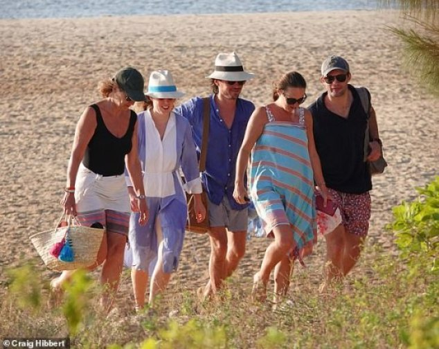 Beatrice and Edo with family members on New Year's Day.Visitors to the island must first fly to Nairobi, then take a short flight to Lamu and complete their journey by boat, landing on a beach