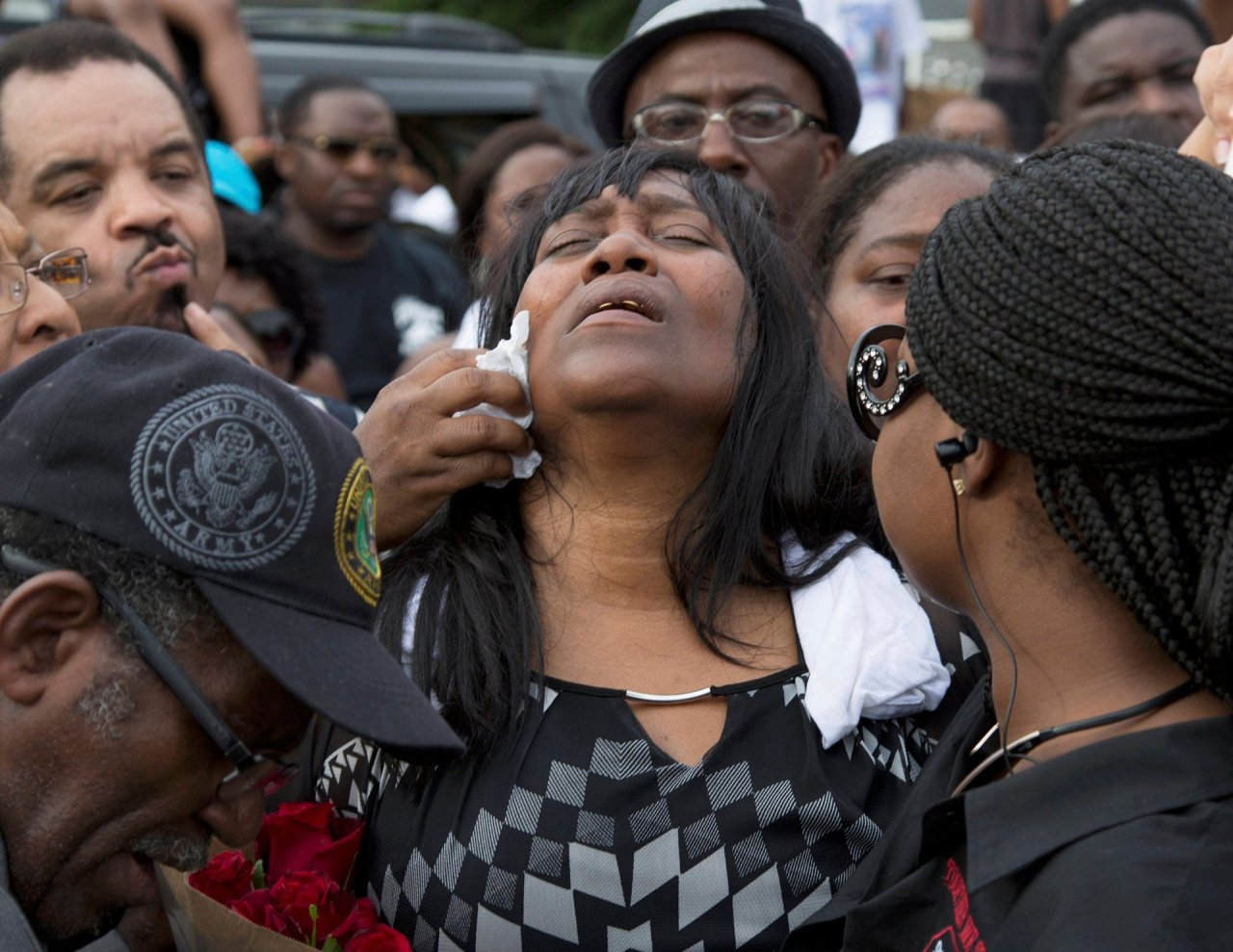 Baton Rouge, USA Sandra Sterling reacts during a community vigil in memory of her nephew, Alton Sterling, who was shot dead by police Photograph: Jeffrey Dubinsky