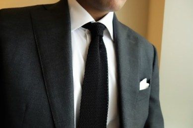 Akshay G. wearing Kent Wang black knit tie