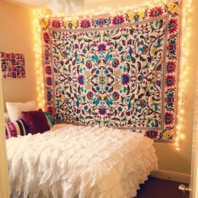 colorful tapestry above full bed in dorm room on clique tips