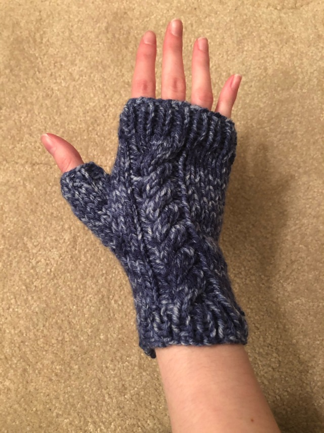 one of the fingerless gloves being modeled on my right hand.