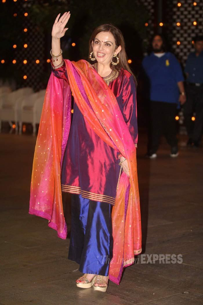 Nita Ambani waving at the Indian contingent at the games. Only the owners were allowed in the dugout.
