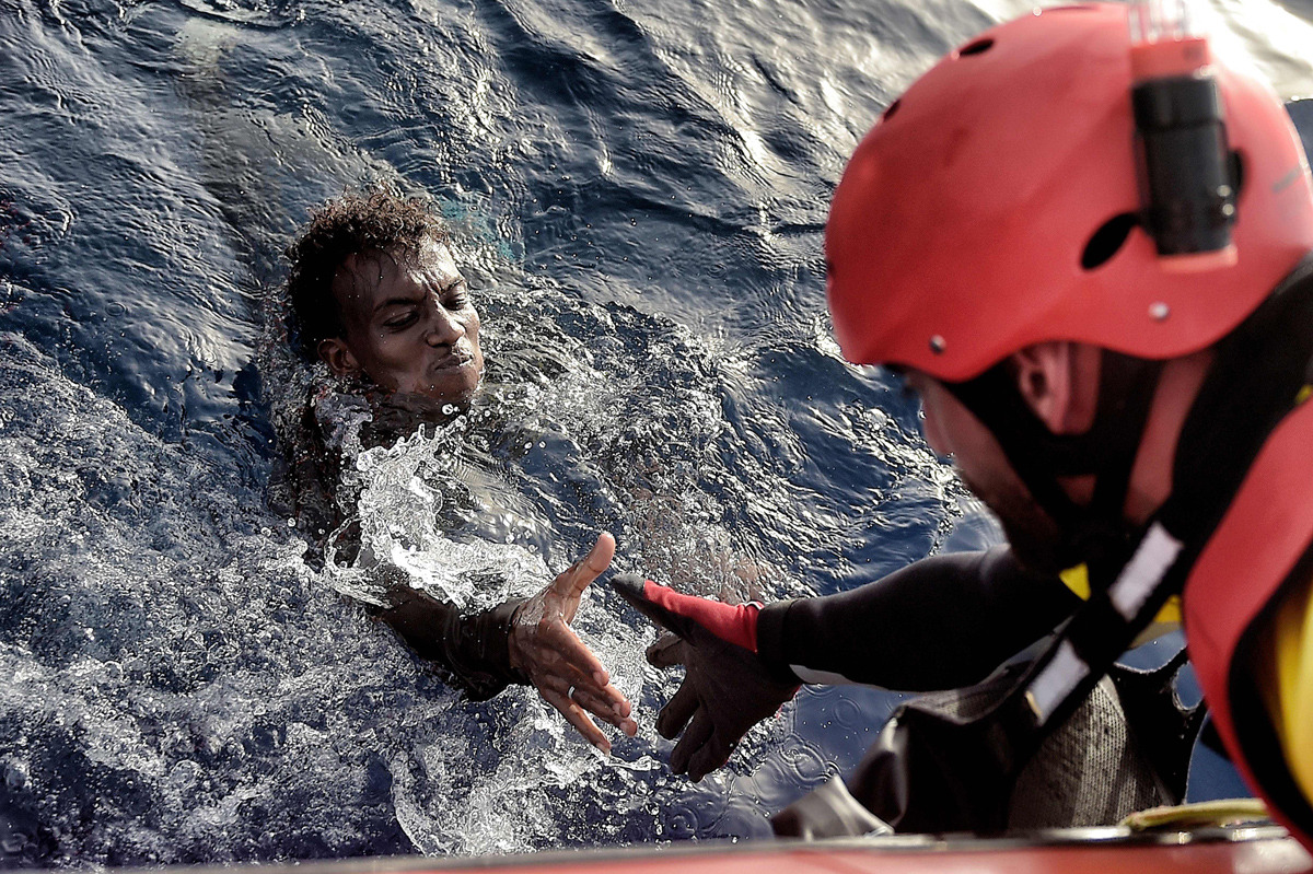 A migrant is rescued from the Mediteranean sea by a member of Proactiva Open Arms NGO some 20 nautical miles north of Libya on October, 2016. Aris Messinis