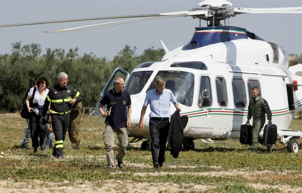Italian State Secretary to the Prime Minister Graziano Delrio, center, arrives at the site. Reuters