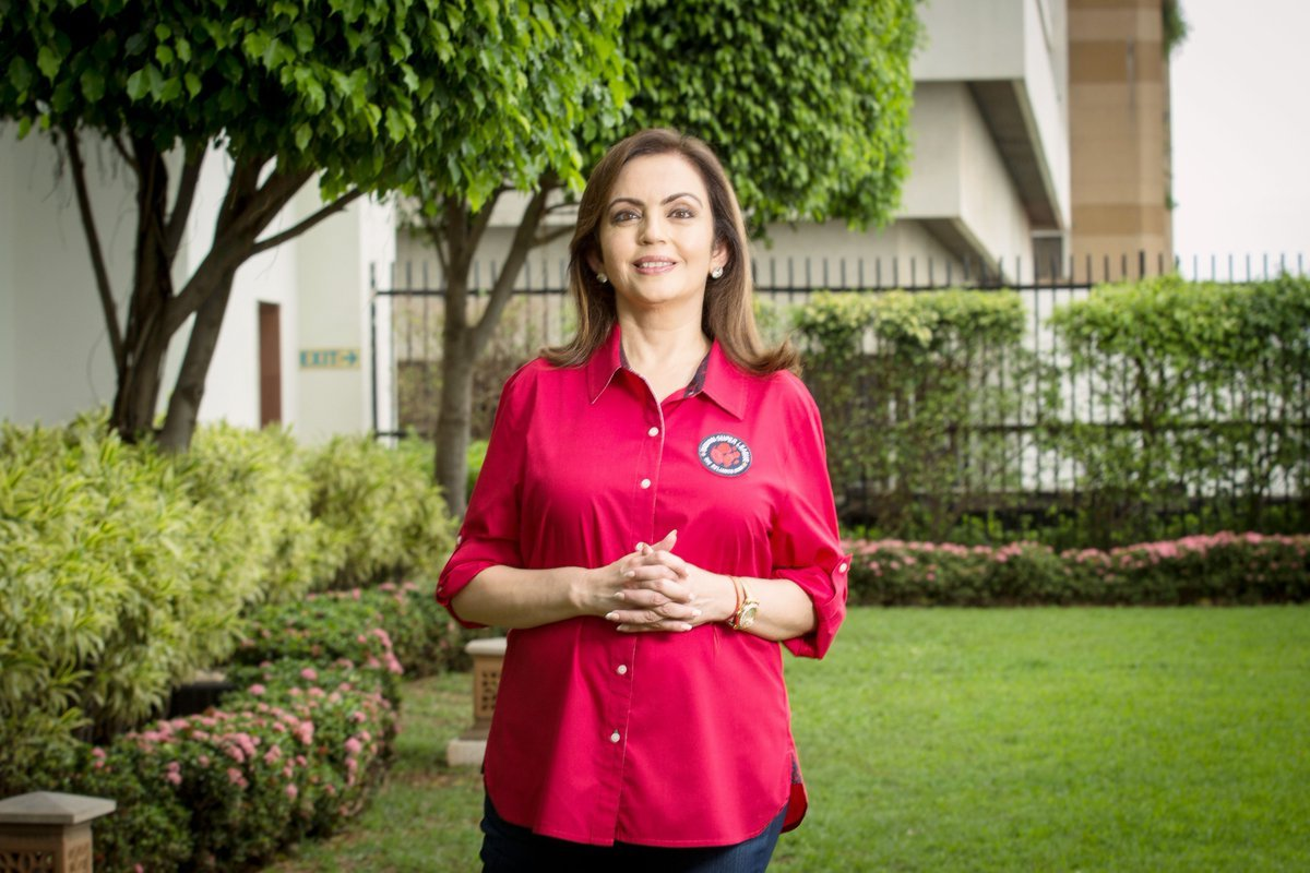 Nita Ambani getting her picture clicked outside her games village outside the games village.
