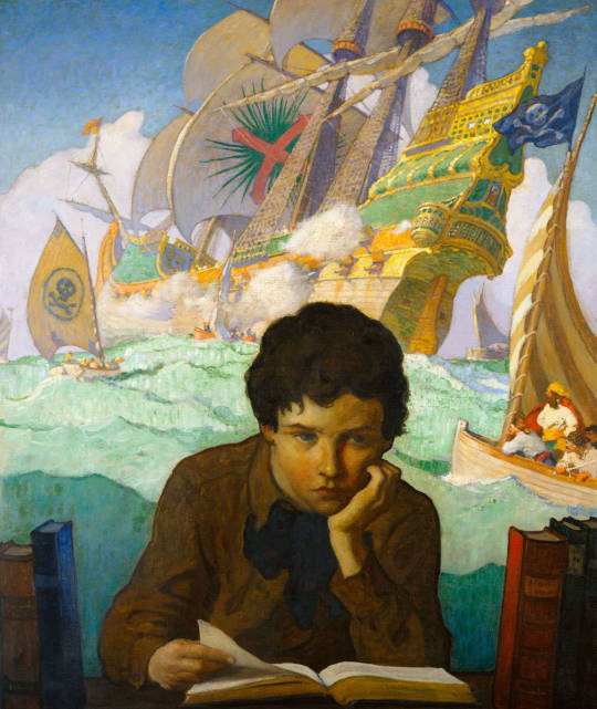 A boy reads and dreams of pirate ships