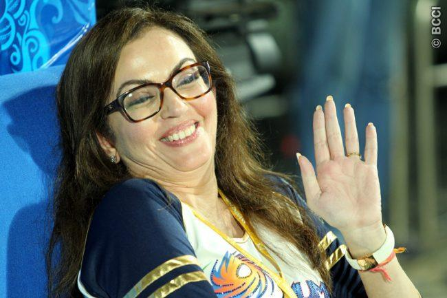 Nita Ambani reacting with disbelief on being told that she came first, second and third in the 100 m sprint.