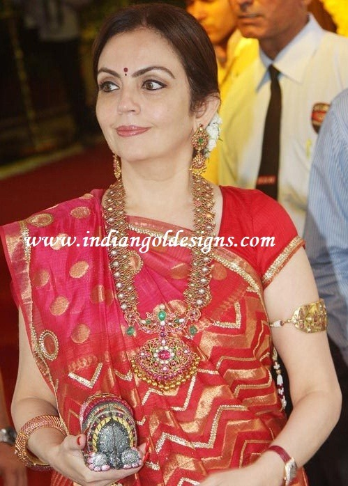 Nita Ambani showcasing one of her hard earned gold medals.