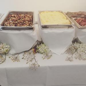a display of breakfast foods for a catered event