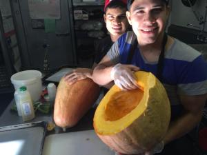 Picture of Cooks holding Candy Roaster Squash by 67 Biltmore Downtown Eatery and Catering