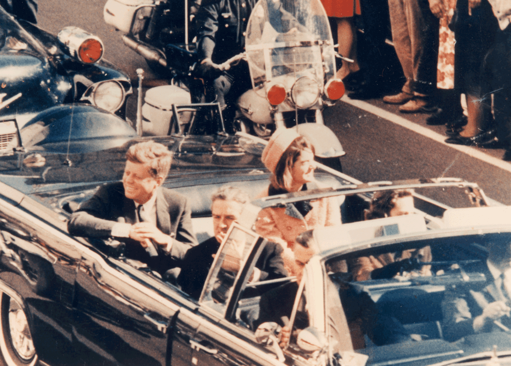 Picture of the JFK´s limousine in Dallas, TX. (Main Street) (cut-off version)