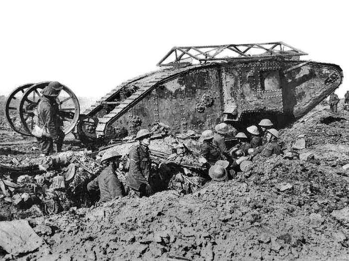 "An early model British Mark I ""male"" tank, named C-15, near Thiepval, 25 September 1916. The tank is probably in reserve for the Battle of Thiepval Ridge which began on 26 September. The tank is fitted with the wire ""grenade shield"" and steering tail, both features discarded in the next models."