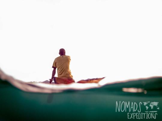 man boat papua triton bay fishing traditional spear paddle ocean