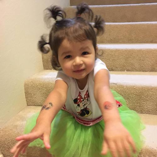 """Ready for """"wacky Wednesday"""" dress up day at school with sprouted hair, tutu I bought for her when she was 3 months old, and 2 day old Halloween tattoos #KidRefusedToTakeANormalPicture"""