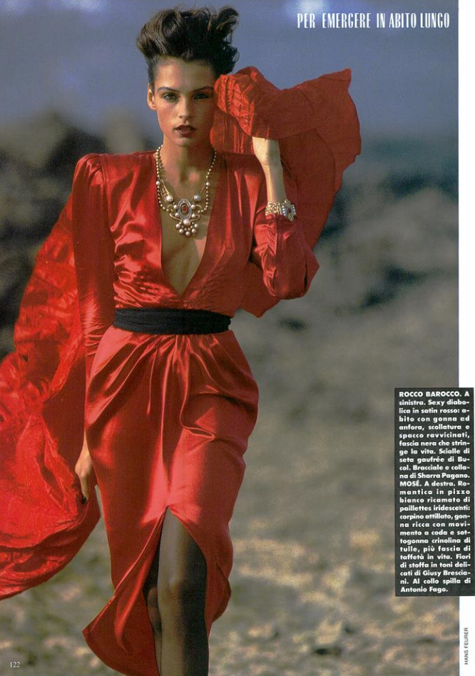 Famke Janssen photographed by Hans Feurer in red Rocco Barocco for Vogue Italia, December 1986