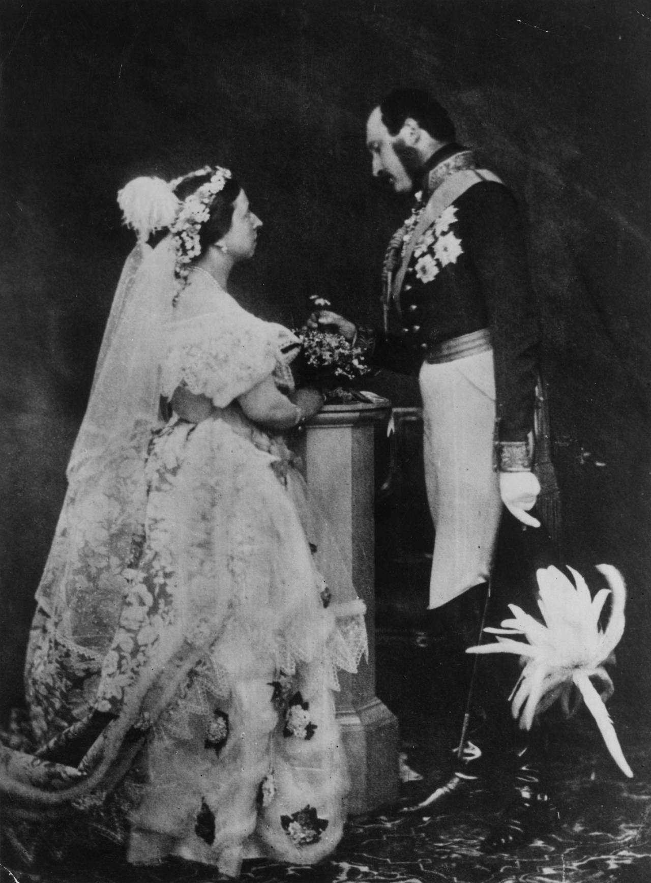 Queen Victoria and Prince Albert re-enact their wedding ceremony, around 14 years later. C.1854.
