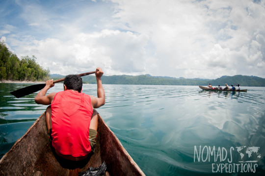 nowhere papua indonesia forest jungle wild wilderness tribal traditional culture travel adventure explore trek discover journey guide wonder dangerous survival village island tropical remote undiscovered boat canoe crocodile lake saltwater paddle travel