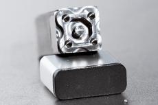 Hartmetall Bauteil mit aussen/innen Kontur und 4 Bohrungen