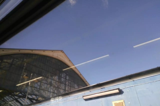 Brighton train station's arched roof, seen through a train window