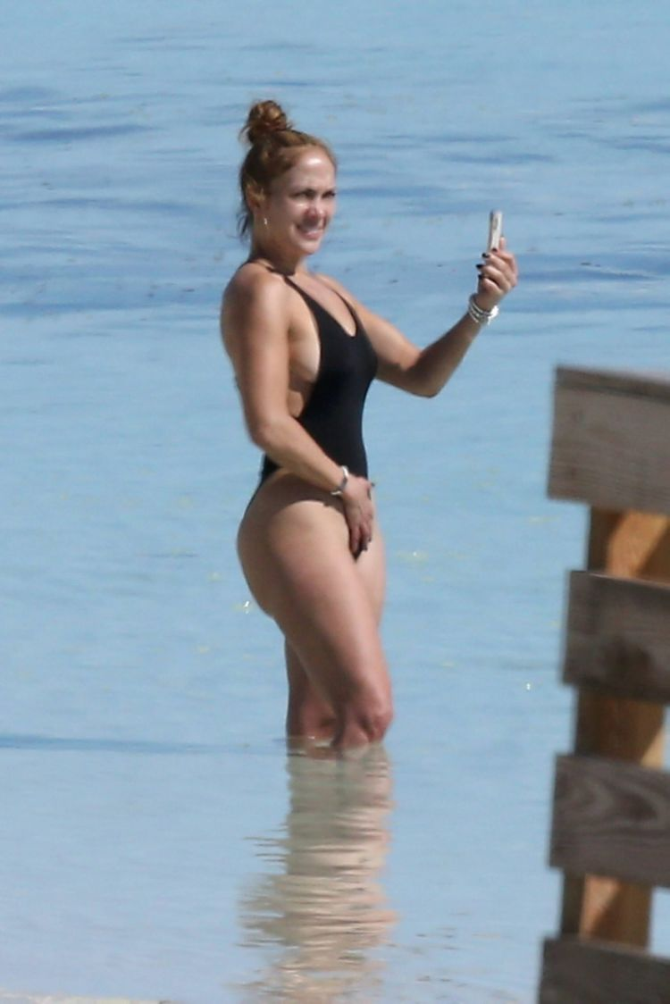 Jennifer Lopez Vacationing In A Black Swimsuit On The Beach In Turks And Caicos