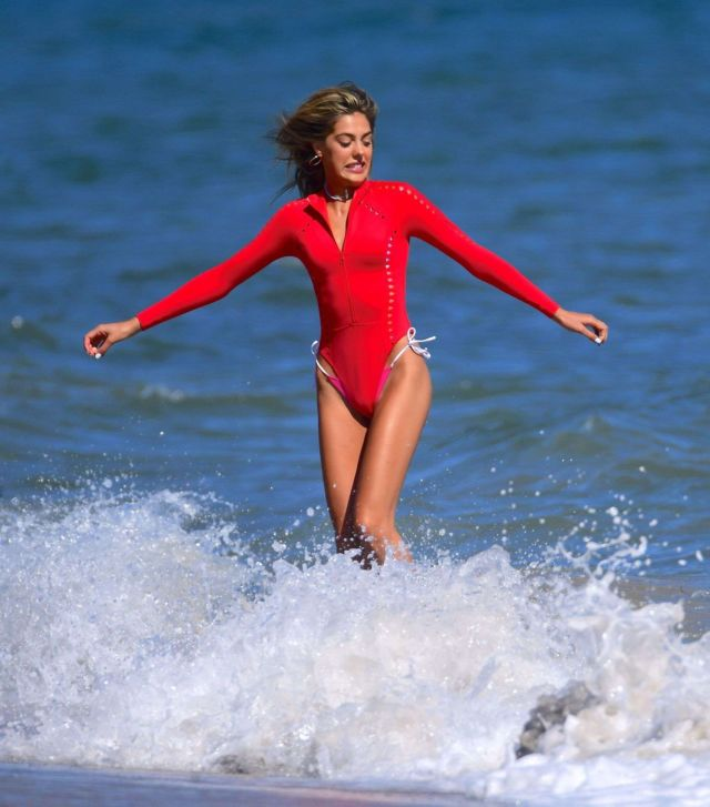 Sistine Stallone Vacationing In A Red Swimsuit With Her Family At The Beach