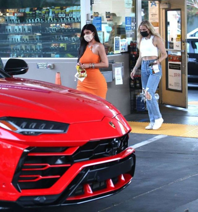 Kylie Jenner Looks Stunning In An Orange Dress At A Gas Station In Bel Air